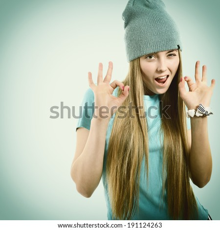 Beautiful joyful girl hipster looking at camera, happy smiling and gesturing ok - stock photo