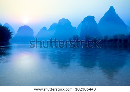 beautiful karst mountain landscape at sunrise in yangshuo,guilin,China - stock photo