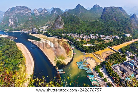 Beautiful karst mountains and the Li River. View from the hill above town of the Hingping - China - stock photo
