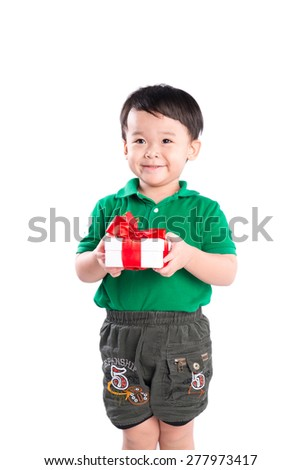 Beautiful kid holding present. Mothers day celebration concept - stock photo