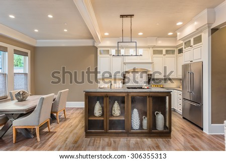 Beautiful Kitchen and Dining Room in New Luxury Home   - stock photo