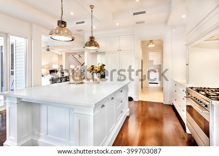 Beautiful kitchen having electrical automatic cooking gas and fruits, flowers kept on table - stock photo