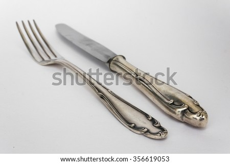 beautiful knife and fork - sterling cutlery, silver flatware set - stock photo