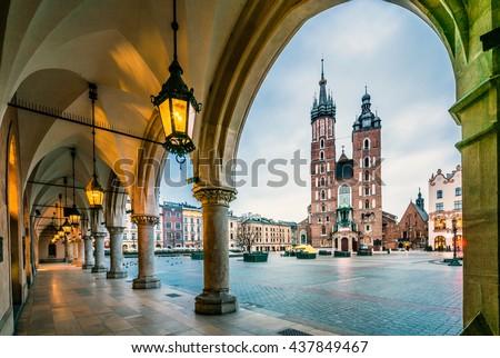 Beautiful Krakow market square, Poland, Europe. Faded colors. - stock photo