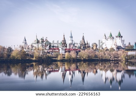 Beautiful Kremlin to Izmailovo is reflected in water, Moscow, Russia. Toning - stock photo