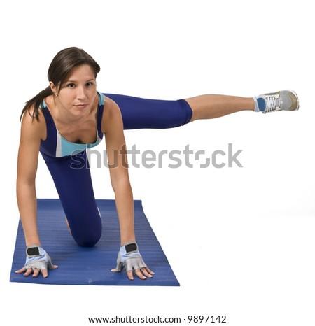 Beautiful;l brunette doing aerobics. - stock photo