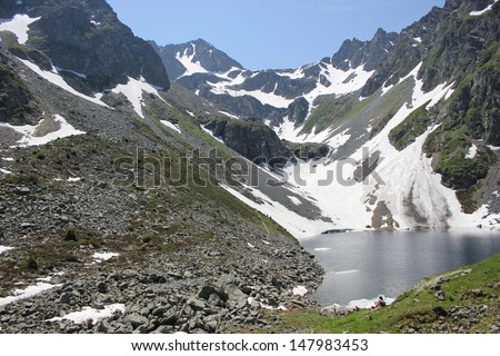 Beautiful Lac de Crop in Belledonne Massif, Alps during summer. - stock photo