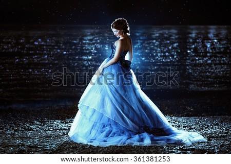 Beautiful lady in blue dress - stock photo