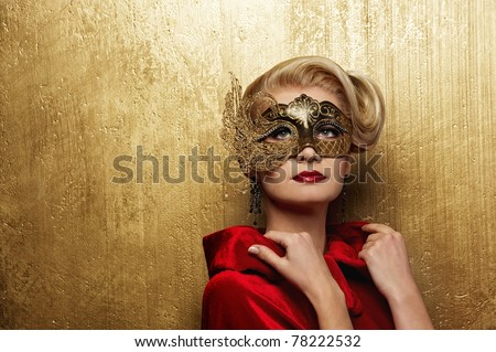 Beautiful lady in carnival mask - stock photo