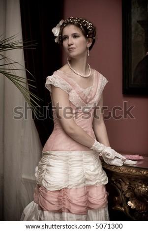 Beautiful lady in luxury interior - stock photo