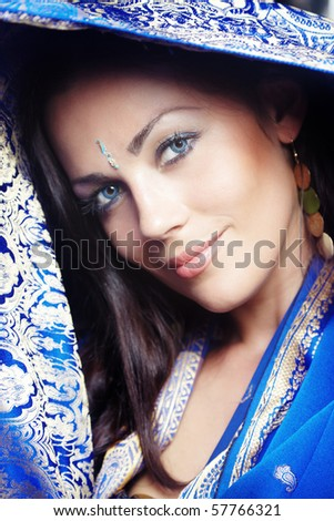Beautiful lady in the blue traditional sari. Close-up portrait. India - stock photo