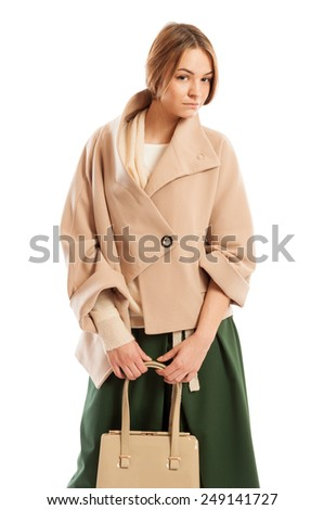 Beautiful lady model posing while wearing spring fashion clothes - stock photo