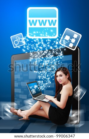 Beautiful lady present the World Wide Web icon from tablet PC - stock photo