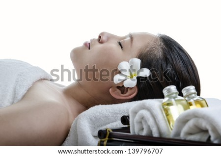 Beautiful lady relaxing at spa treatment against white background - stock photo