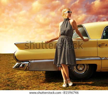 Beautiful lady standing near retro car. - stock photo