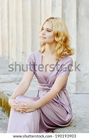 beautiful lady wearing long dress - stock photo