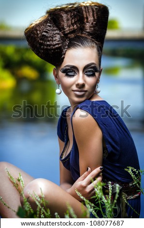 Beautiful lady with an improbable hairdress - stock photo