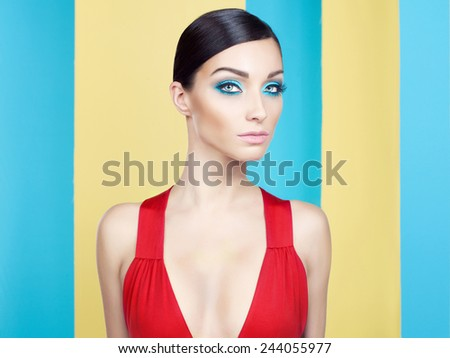 Beautiful lady with colorful makeup on colorful background - stock photo