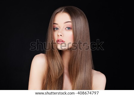 Beautiful Lady with Long Hair on Black Background - stock photo