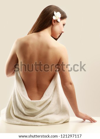 beautiful lady with white towel on white background - stock photo