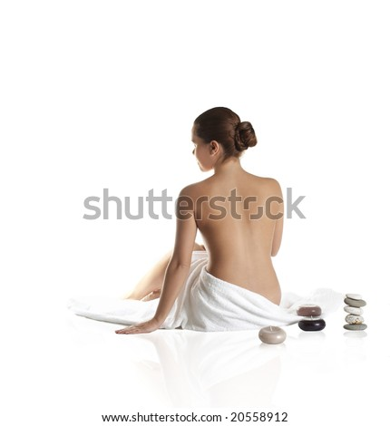 beautiful lady with wite towels on white sand - stock photo