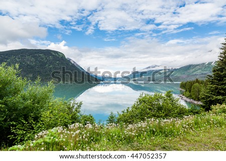 Beautiful lake and mountains in Alaska with reflections - stock photo
