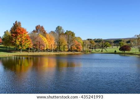 Beautiful Lake and Trees in Autumn - stock photo