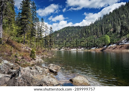 Beautiful lake in the mountains, called Amut. - stock photo
