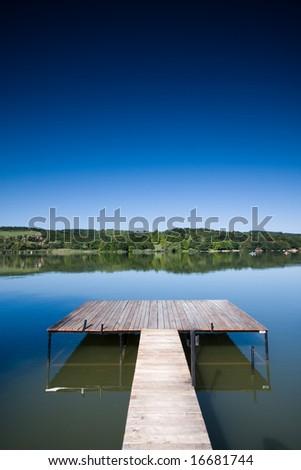 Beautiful lake scene of a wooden pier - stock photo