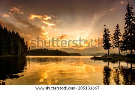Beautiful lake view at sunrise - stock photo