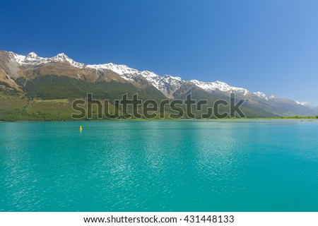 Beautiful lake Wakatipu with mighty mountains reflecting in water at Glenorchy. Otago region, New Zealand - stock photo