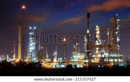beautiful landscape dusky sky of heavy industry oil refinery plant with dazzling lighting  - stock photo