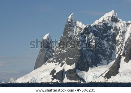 Beautiful landscape in Antarctica. Some snow covered mountains. - stock photo