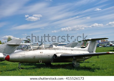 Beautiful landscape in the airport with old  aircraft on the background of the cloudy sky - stock photo