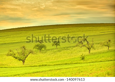 Beautiful landscape in the spring season with luminously bright colors like in an artwork - stock photo