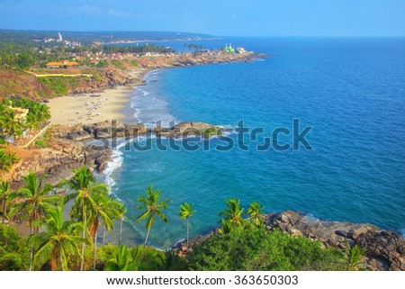 Beautiful landscape of beach and clear turquoise sea. Thiruvananthapuram, India - stock photo
