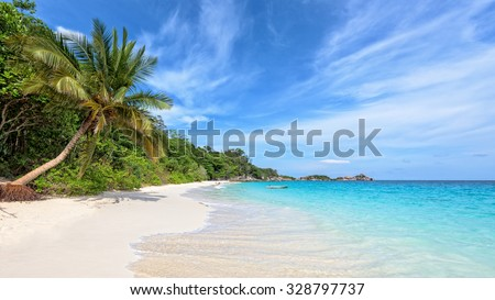 Beautiful landscape of blue sky coconut sea sand and waves on the beach during summer at Koh Miang island in Mu Ko Similan National Park, Phang Nga province, Thailand, 16:9 widescreen - stock photo