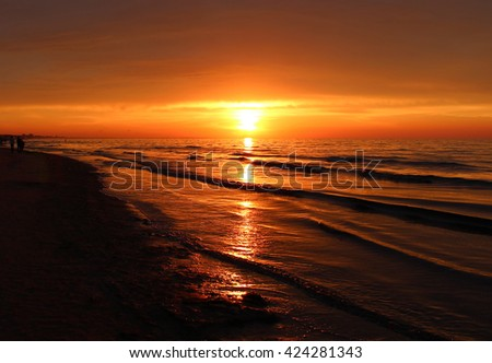 Beautiful landscape of summer sunset or sunrise and evening nature background. Rest on summer beach. Golden summer sunset. Orange summer sunset. Summer time.  - stock photo