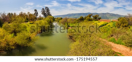 Beautiful landscape of the mountains of Galilee and Golan Heights via Jordan River - stock photo