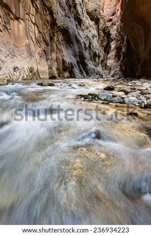 beautiful landscape of the Narrows in Zion National park with the virgin river flowing through the slot canyon - stock photo