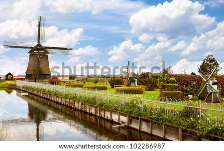 Beautiful landscape of the Netherlands with a windmill - stock photo