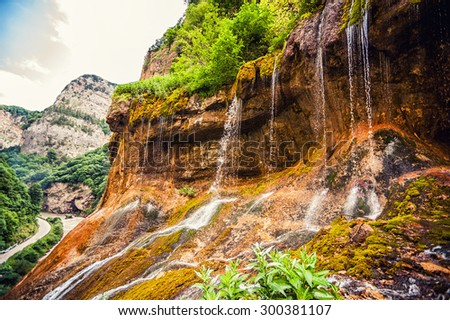 Beautiful landscape of top tier of Chegem waterfalls in canyon. Chegem district of Kabardino-Balkaria, Russian Federation. - stock photo