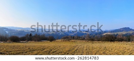 Beautiful landscape panorama. Czech Republic. Meadow, mountains and clouds on a spring day. - stock photo