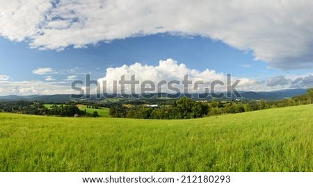 Beautiful landscape panorama in the Jizera Mountains in the Czech Republic.  Meadow, mountains and clouds on a summer day. - stock photo