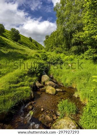 Beautiful landscape rapids on a mountains river in sunlight.Scotland,  Dollar Glen,  near the castle Campbell - stock photo