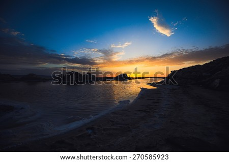 beautiful landscape sunrise and sunset the sun at the salt lake in the Sahara desert - stock photo