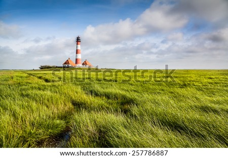 Beautiful landscape with famous Westerheversand lighthouse in the background at North Sea in Nordfriesland, Schleswig-Holstein, Germany - stock photo