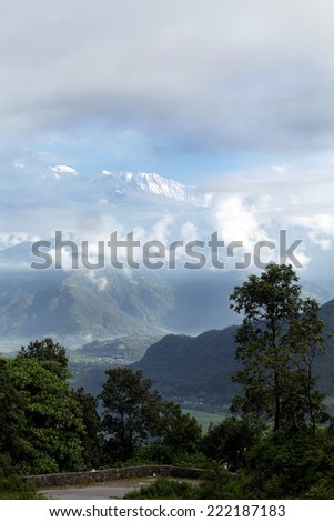Beautiful landscape with glimpse of Annapurna range - stock photo