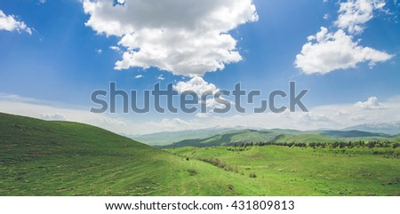 Beautiful landscape with green mountains and magnificent cloudy sky. Exploring Armenia - stock photo