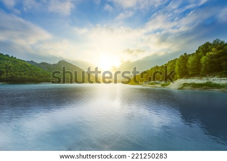 Beautiful landscape with lake at sunset - stock photo